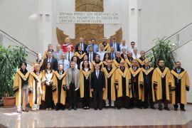 Unvanda yükselen öğretim üyelerine cübbeleri giydirildi